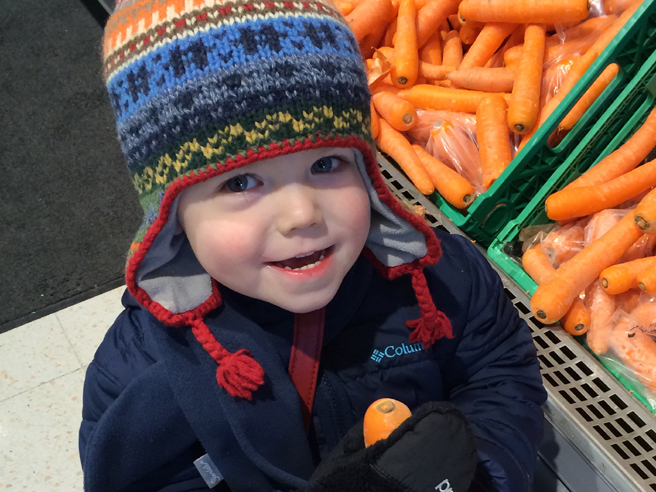 Toddler with carrot