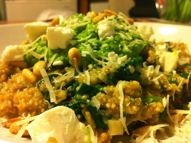 Quinoa risotto with mashed peas and greens